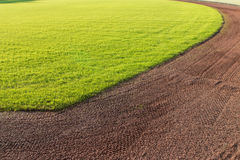 Outfield Grass And Warning Track Dirt Of Baseball Field Stock Photo