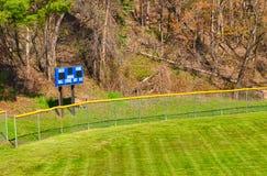 Outfield scorebord met herten eronder Stock Fotografie