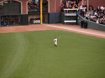 Outfielder Cody Ross throws ball to warm up Royalty Free Stock Photos