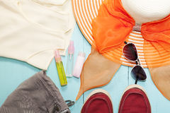 Outfit of clothes and woman accessories on blue wooden backgroun. D,essential vacation items for travel and summer travel background Stock Photo