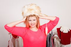 Attractive woman wearing furry winter hat Stock Photography