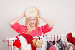 Attractive woman wearing furry winter hat Stock Photos