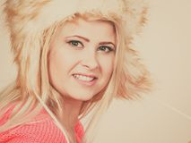 Attractive woman wearing furry winter hat Royalty Free Stock Photos