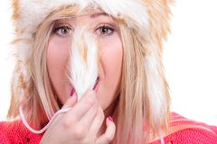 Attractive woman wearing furry winter hat Royalty Free Stock Photography