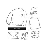 Outfit of the day. Hand drawn clothes in linear style flat lay / top view. Outfit of the day. Hand drawn clothes: sweater, skirt, slip-ons, beanie, etc in linear Royalty Free Stock Images