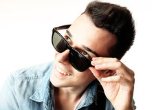 Outfit of a fashion guy with jacket and black sunglasses on white background studio Stock Images