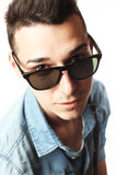 Outfit of a fashion guy with jacket and black sunglasses on white background studio Royalty Free Stock Photos