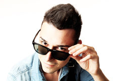 Outfit of a fashion guy with jacket and black sunglasses on white background studio Royalty Free Stock Photography
