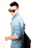 Outfit of a fashion guy with jacket and black sunglasses on white background studio Royalty Free Stock Images