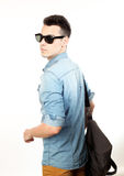 Outfit of a fashion guy with jacket and black sunglasses on white background studio Stock Photo