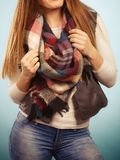 Outfit idea. Jeans scarf, white top with black vest Royalty Free Stock Image