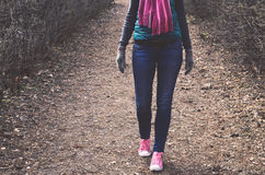 Outfit - jeans, knitted scarf, jacket, trainers and mittens Stock Photography