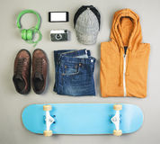 Outfit of skater man on grey background. Stock Images