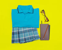 Outfit of student.Different objects on color background. Royalty Free Stock Photography