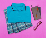 Outfit of student.Different objects on color background. Royalty Free Stock Image