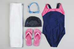 Outfit of swimming woman on grey background. Royalty Free Stock Photo