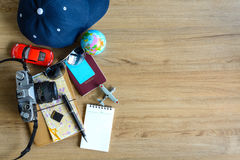 Outfit of traveler with copy space on wooden background Stock Photos