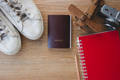 Outfit of traveler, Different objects on wooden background. Royalty Free Stock Photo