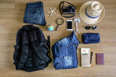 Outfit of traveler on old wooden background Stock Photography