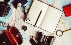 Outfit of traveler. And vacation items. Overhead view of travel accessories. Vintage toned image. Top view. Flat lay Royalty Free Stock Photography
