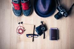 Outfit of traveler, student, teenager, young woman or guy. Overh. Ead of essentials for modern young person. Different objects on wooden background. vintage Stock Photo