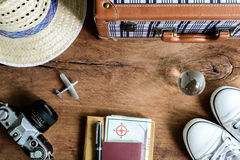 Outfit of traveler on wooden background Stock Photos