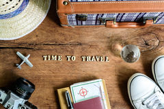 Outfit of traveler on wooden background Royalty Free Stock Photo
