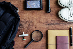 Outfit of traveler on wooden background Stock Images
