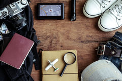 Outfit of traveler on wooden background Stock Image