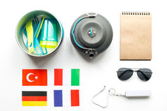Outfit of traveller with flags and plastic glasses white background top view Royalty Free Stock Images