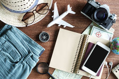 Outfits and accessories of traveler on wooden background stock photo