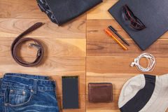 Outfits and accessories of traveler on wooden background Stock Images