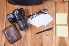 Outfits and accessories of traveler on wooden background Stock Photography