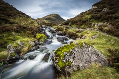 The Outflow from Loch Skeen on Tail Burn above The Grey Mares Ta. A stream flowing from Loch Skene which leads into the water fall know as The Grey Mare Tail in Royalty Free Stock Photos