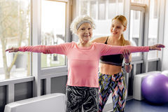 Outgoing beneficiary doing workout in fitness center Stock Photo
