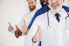 Outgoing doctors showing all is okay Royalty Free Stock Images