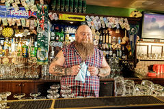 Outgoing fat bartender locating in tap-room Stock Photo