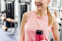 Outgoing female drinking water in gym Royalty Free Stock Photo