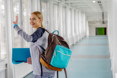 Outgoing female taking leave in hall Royalty Free Stock Images