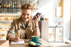 Outgoing female writing in copybook Royalty Free Stock Images