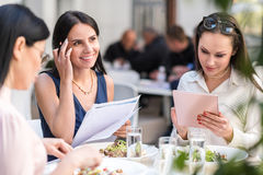 Outgoing females filling up form stock image