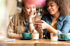 Outgoing friends speaking in confectionary shop Stock Photography