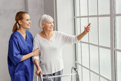 Outgoing grandmother demonstrating physician what is going on Stock Photos