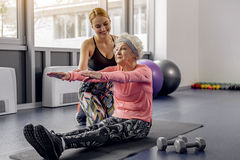 Outgoing lady training laughing granny Royalty Free Stock Photos