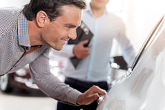 Outgoing male looking at automobile interior Stock Image