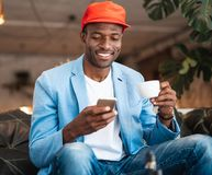 Outgoing male typing in mobile Royalty Free Stock Photo