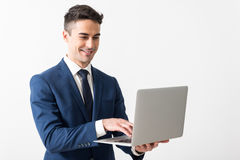 Outgoing male working with notebook computer Royalty Free Stock Photography