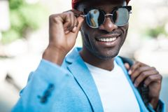 Glad male wearing contemporary spectacles. Outgoing man in modern sunglasses looking at camera. Fashion concept Royalty Free Stock Images