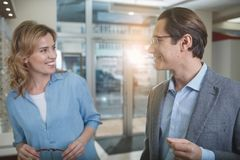 Cheerful husband and wife choosing glasses royalty free stock image