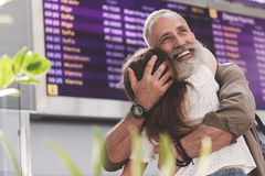 Outgoing Old Man Hugging Girl On Meeting Stock Photos